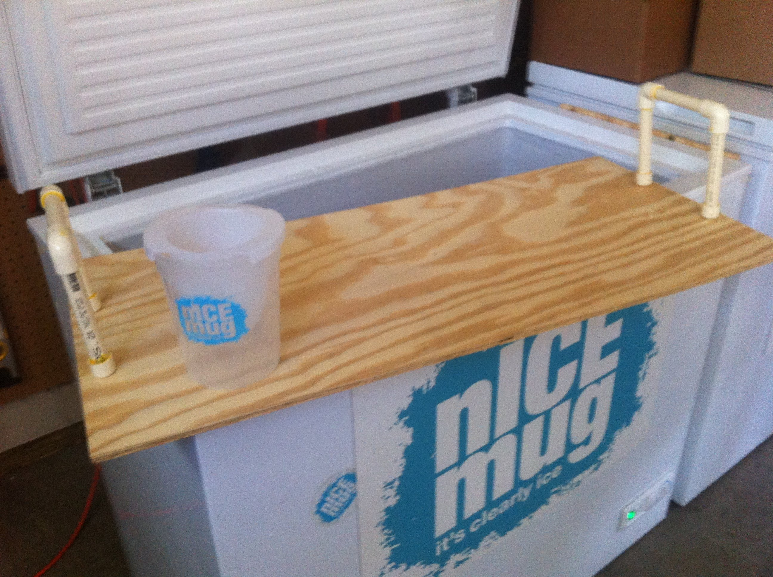The finished product.  wood shelves cut to size and note the raggamuffin yet functional CPVC shelf handles.