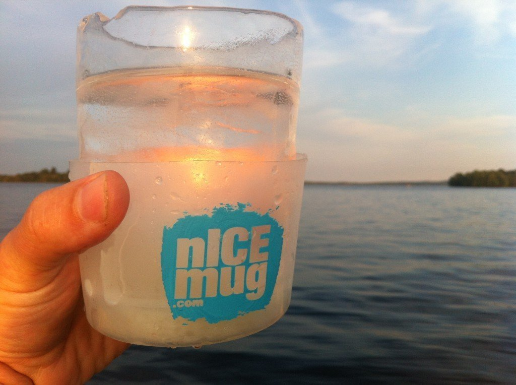 Cheering clear ice on a Northern Lake on a warm summer evening.